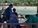 wisatawan-harus-menjalankan-protokol-kesehatan-saat-masuk-di-pulau-maratua.jpg