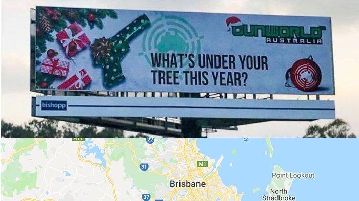 Di Brisbane Australia, Pistol Muncul di Papan Reklame Sebagai Salah Satu Hadiah Natal