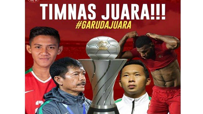 Pelatih Timnas U-22 Indonesia, Indra Sjafri mengangkat trofi saat timnas U-22 Indonesia meraih juara lawan Thailand, Selasa (26/2/2019).