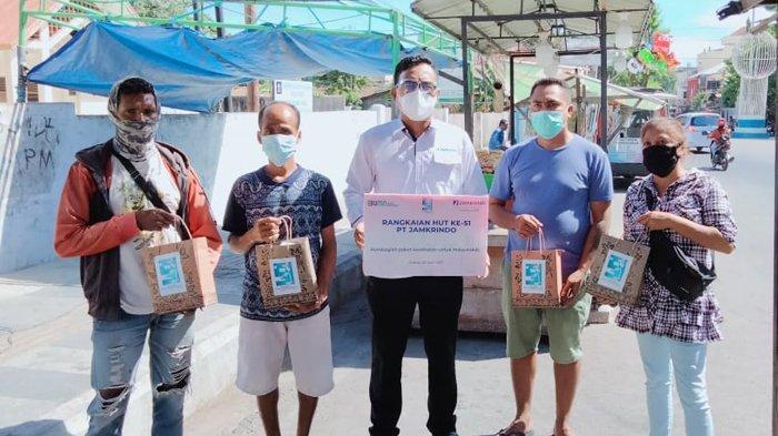 Jelang HUT Ke-51, PT. Jamkrindo Kupang Bagi-bagi Hand Sanitizer, Masker dan Vitamin C
