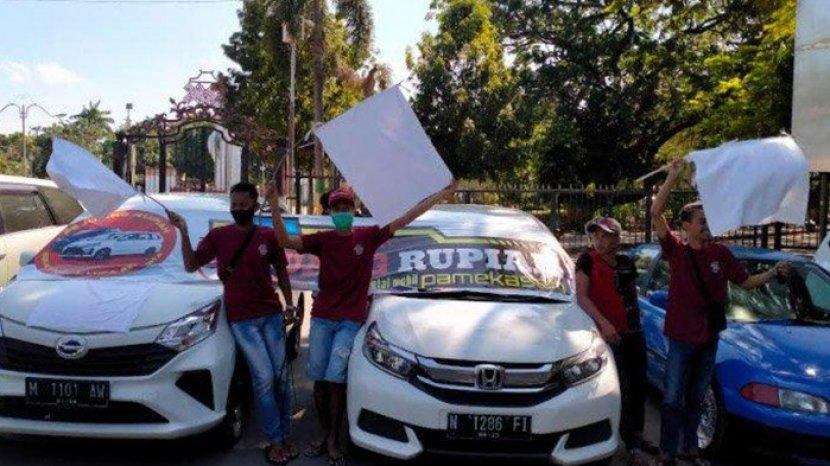 pengusaha-kpr-kibarkan-bendera-putih.jpg