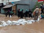 banjir-genangi-ruas-jalan-di-samping-rs-bhayangkara.jpg