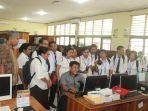 kepala-perpustakaan-sekolah-se-ntt-berkunjung-ke-smk-pp-negeri-kupang.jpg