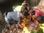 mayat-trans-timor-jembatan-anggota-polisi-saat-sedang-melakukan.jpg