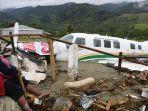 pesawat-terseret-banjir-di-sentani.jpg