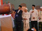 presiden-joko-widodo-kiri-didampingi-menteri-agama-lukman-hakim-saifuddin-kedua-kanan_20180809_195430.jpg