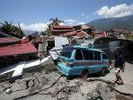 puing-bangunan-di-perumnas-balaroa-akibat-gempa-bumi-yang-mengguncang-kota-palu-sulawesi-tengah_20181001_214022.jpg