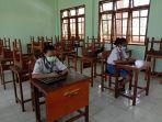 siswa-smak-giovanni-kupang-mengikuti-ujian-di-sekolah.jpg