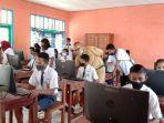 siswa-smp-di-manggarai-timur-ikut-ujian-try-out-berbasis-digital-kepala-sekolah-dukung.jpg