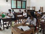 siswa-smp-katolik-adisucipto-penfui-kupang-saat-ptm-di-sekolah.jpg