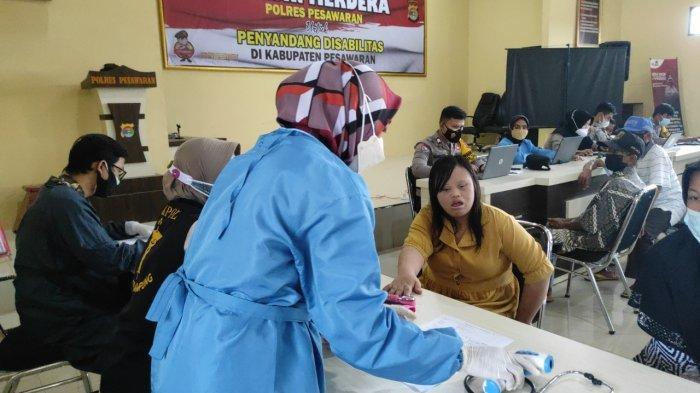 Puluhan Penyandang Disabilitas Dapat Vaksinasi Gratis Polres Pesawaran Lampung
