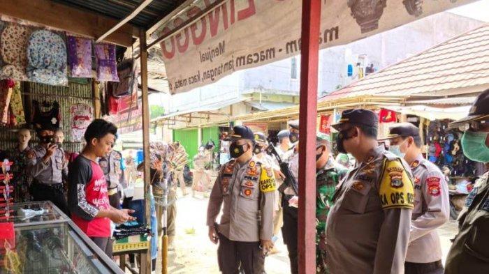 Kapolres Mesuji Pimpin Operasi Yustisi di Pasar Simpang Pematang, Edukasi Protokol Kesehatan