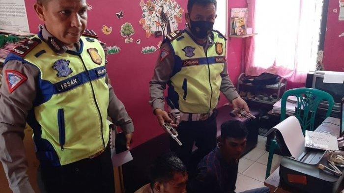 Dua pelaku penodongan senjata api ditangkap polisi. (KOMPAS.com/TRI PURNA JAYA )