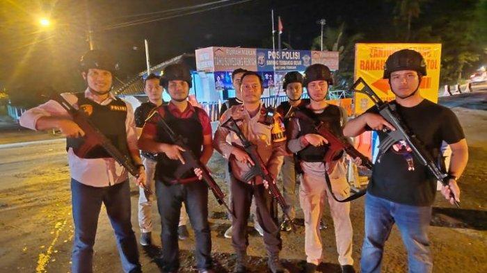 Polisi Bersenjata Jaga Simpang Terbanggi dan Bandar Jaya