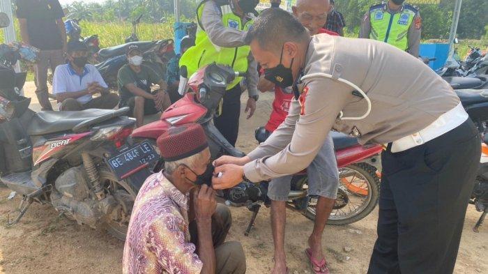 Polres Mesuji Gelar Vaksinasi Gratis hingga Bansos