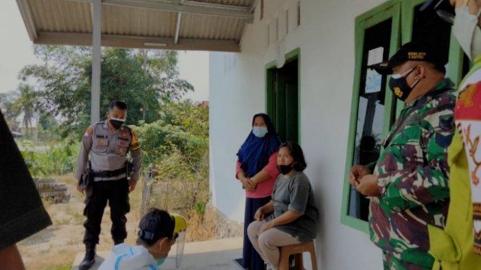 Kodim 0429/Lampung Timur Bersama Puskesmas Pasir Sakti Lakukan Tracing di Rejo Mulyo