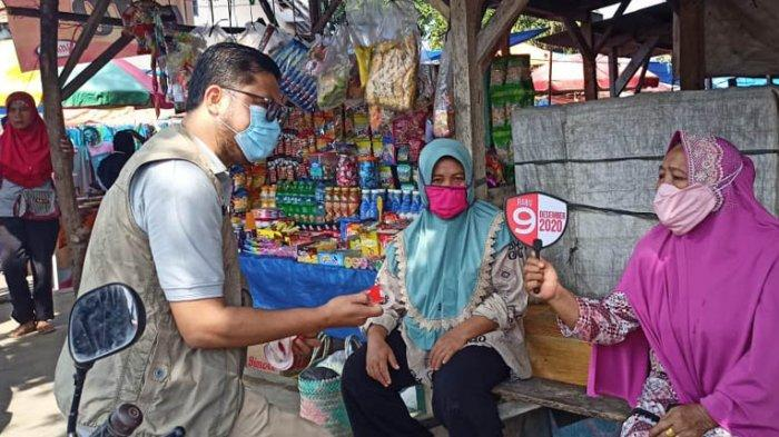Sosialisisasi 12 Hal Baru dalam pelaksanaan pemungutan suara di TPS disosialisasikan KPU Way Kanan di Pasar Banjit.