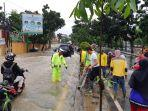 banjir-depan-kampus-satu-nusa-polresta-bandar-lampung-lakukan-rekayasa-lalu-lintas.jpg