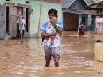banjir-desa-rangai-katibung-1.jpg