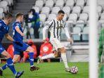 cristiano-ronaldo-mencetak-gol-ke-750.jpg