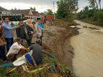 dprd-pringsewu-tinjau-lokasi-terdampak-banjir-pardasuka-minta-penguatan-tanggul-sungai-way-mincang.jpg