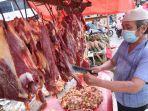 foto-harga-daging-sapi-di-pasar-bambu-kuning-bandar-lampung-rp-150-per-kg.jpg
