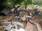 jenazah-yang-terangkat-dari-kubur-ditemukan-di-atas-pohon-keesokan-hari-bpbd-sebut-akibat-sampah.jpg