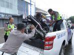 motor-petugas-kebersihan-yang-ditabrak-sedan-bmw-di-bandar-lampung-hancur-lihat-foto-fotonya-4.jpg