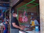 pedagang-daging-sapi-dan-kambing-di-pasar-simpang-pematang-pematang.jpg