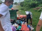 pemulung-mencari-makanan-di-tempat-sampah.jpg