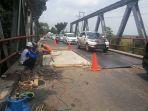 perbaikan-jembatan-bujung-tenuk_20180913_161717.jpg