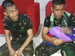 prajurit-tni-selamatkan-bayi-dari-banjir-bandang-sentani.jpg