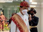 presiden-jokowi-mengenakan-pakaian-adat-lampung.jpg