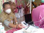 tak-lolos-skrining-kesehatan-sekkab-tulangbawang-batal-vaksinasi-covid-19.jpg