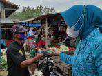 tp-pkk-lampung-tengah-bagikan-ratusan-masker-dan-face-shield-kepada-masyarakat-di-9-kecamatan.jpg