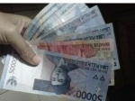 uang-paslu-pecahan-Rp-50-ribu-dan-Rp-100-ribu.jpg