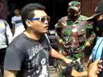 viral-video-pria-tak-percaya-covid-19-tolak-diberi-sanksi-saat-razia-masker.jpg