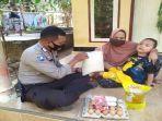bripka-zunaidin-membantu-anak-disabilitas-di-lombok-barat.jpg