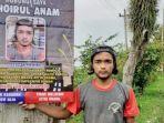 pemuda-asal-kecamatan-kaliangkrik-bernama-khoirul-anam-membagikan-cerita-saat-membuat-spanduk-unik.jpg