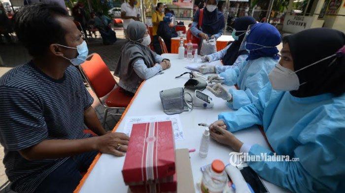 pelaksanaan vaksinasi Covid-19 di Surabaya