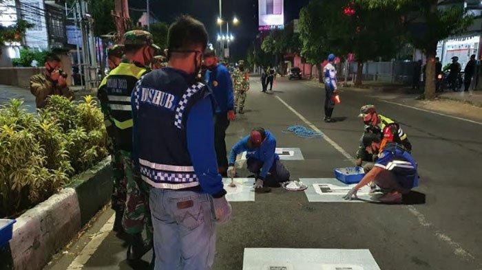 Persimpangan Jalan di Kota Malang Dipasang Starting Grid, Pengendara Terapkan Physical Distancing