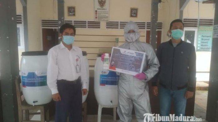 Pandemi Covid-19, PHE WMO Perkuat Perlindungan Warga Bangkalan dengan Masker dan Hand Sanitizer