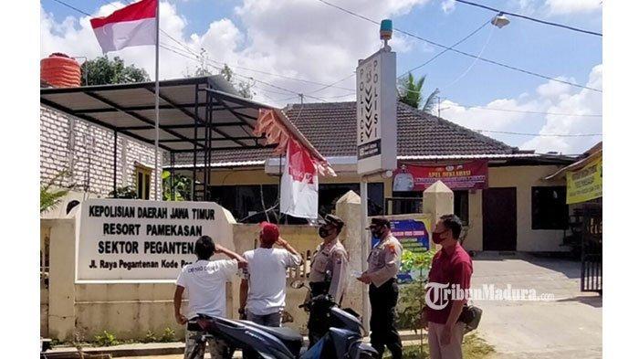 Di Bawah Terik Sinar Matahari, Dua Warga Pamekasan Disanksi Hormat Bendera Karena Tak Pakai Masker