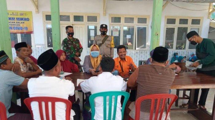 112 Warga Desa Larangan Dalam Pamekasan Terima BST, Proses Pencairan Diawasi Ketat oleh TNI-Polri