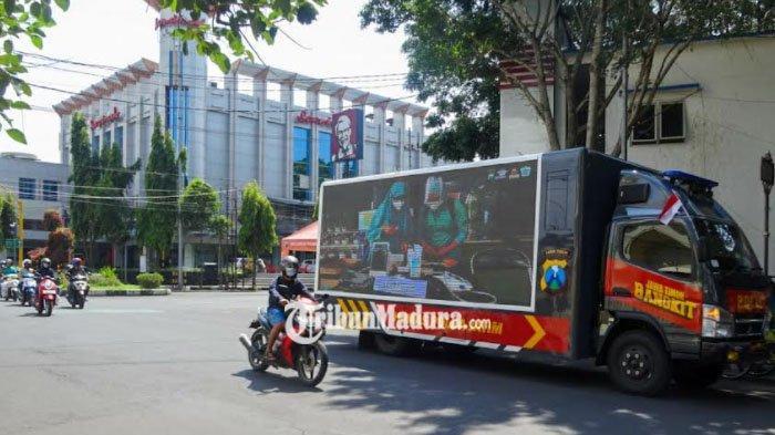 Sosialisasi Prokes, Polda Jatim Turunkan Mobil Videotron di Jalanan Kota Malang