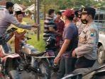 18-motor-pemuda-pamekasan-diamankan-saat-balap-liar-di-jalan-raya-palengaan-daja.jpg