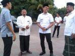 anggota-komisi-c-fraksi-pdi-perjuangan-dprd-jatim-mahfud-dan-bupati-bangkalan.jpg