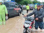 banjir-madiun-jalan-raya-madiun-surabaya-di-desa-garon-kecamatan-balerejo-yang-masih-kebanjiran.jpg
