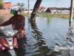 banjir-merendam-jalan-morowudi-yang-merupakan-akses-penghubung-dua-kecamatan-terputus.jpg