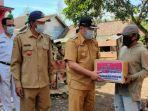 bpbd-bondowoso-memberikan-bantuan-kepada-warga-desa-jatitamban-dan-sumber-malang.jpg